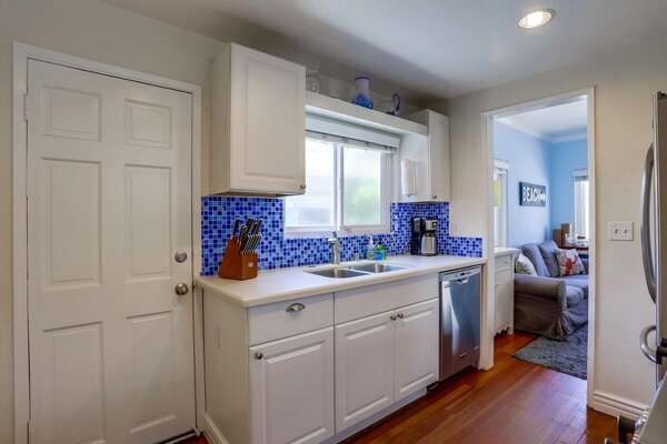 Kitchen Includes White Cabinets.