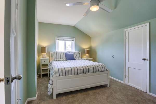Spacious Bedroom Includes Queen Bed.