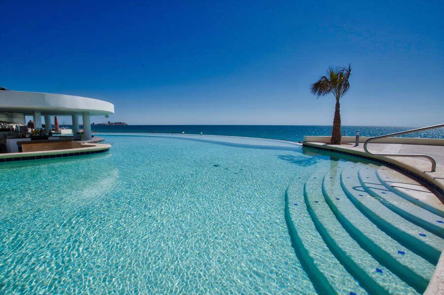 Enjoy the new beachfront pool with swim up bar!