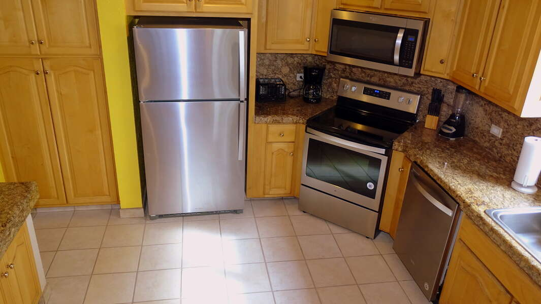 The kitchen is set with all new stainless steel appliances!