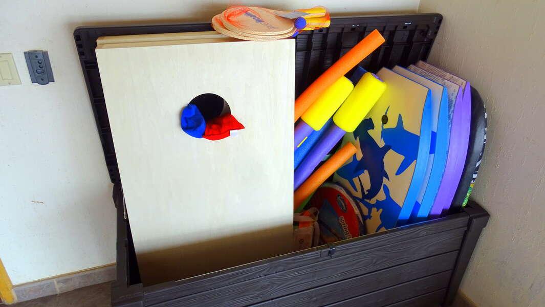 Toy Box! Boogie boards, paddle ball, cornhole, plus more fun!