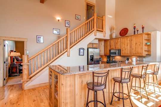 Kitchen and upstairs to private Junior Master suite