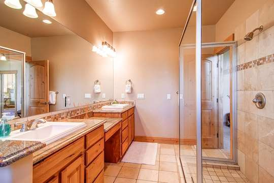 Master Bath with glass shower and soaking tub