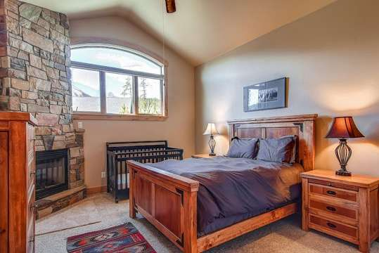 Private upstairs junior master suite with private bathroom and fireplace