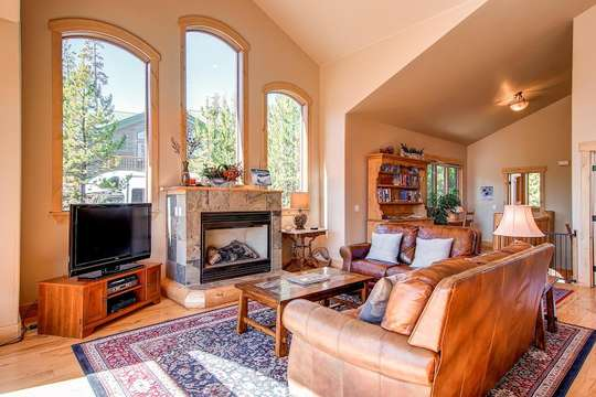 Fireplace, picture windows in Living Area