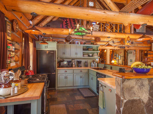 The open-plan Kitchen is equipped with everything needed for cooking and entertaining