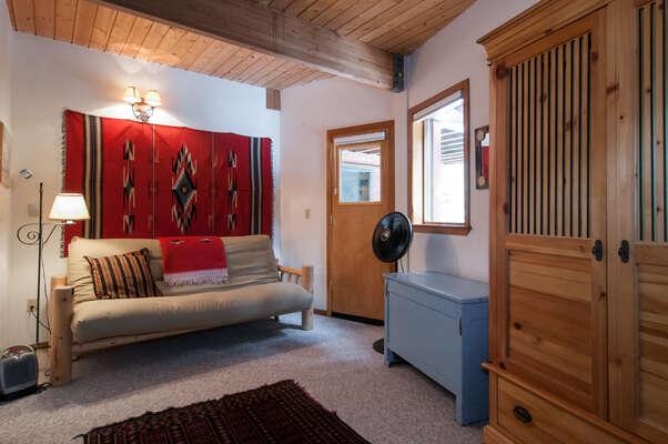 futon in downstairs queen bedroom