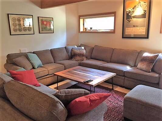 brand new high end sectional with queen sofa bed in family room