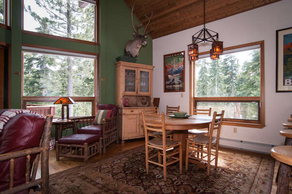 great room with open plan, big windows to take in the forest views - dining table has extra leafs and chairs