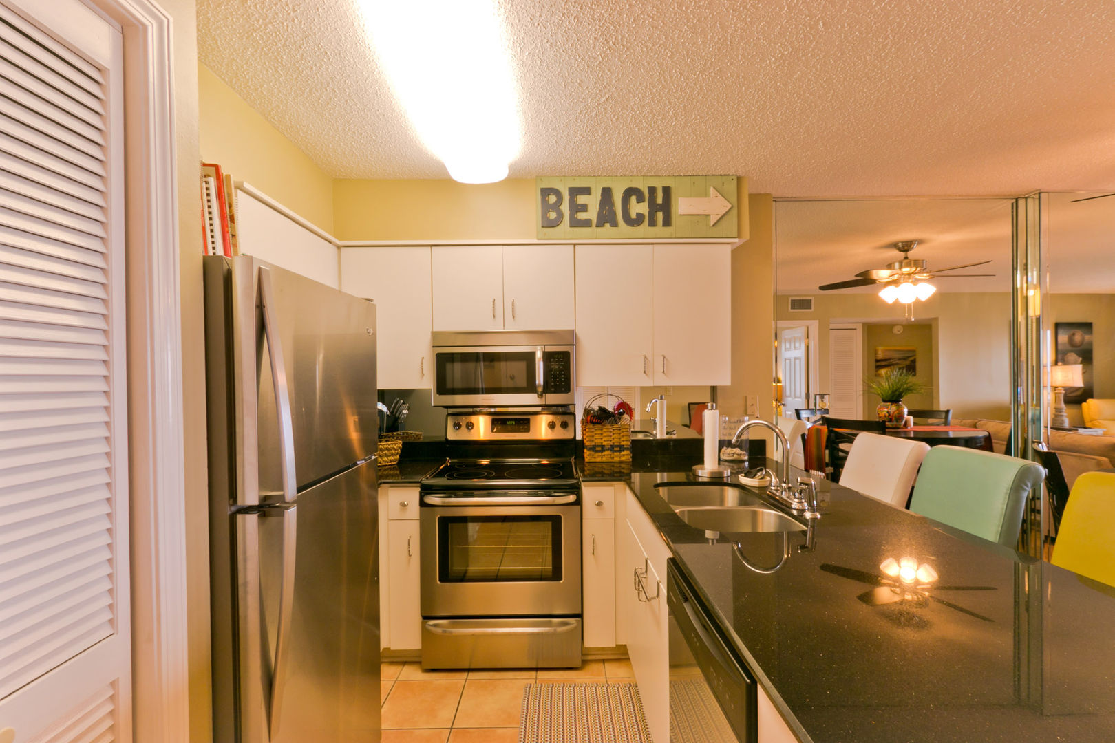 Kitchen with stainless appliances, granite, and a bar area for extra seating