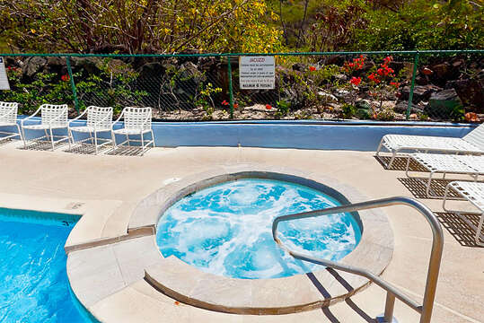 Community Hot Tub with Handlebar Surrounded by Outdoor Chairs.
