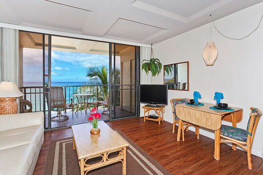 Breakfast Table, Chairs, Coffee Table, Sofa, and Patio Chairs in the Balcony with Oceanview.