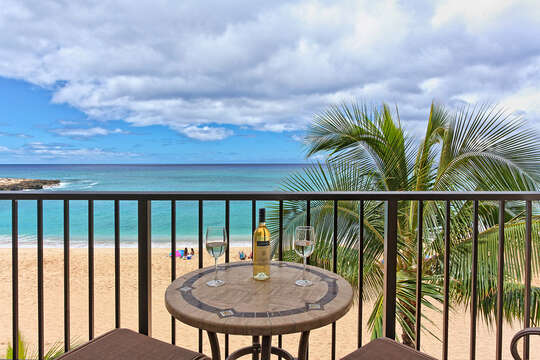 Patio Table in the Balcony, Wine Bottle, Glasses, and the Ocean View.
