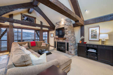 Large Living area with timbers and gas fireplace