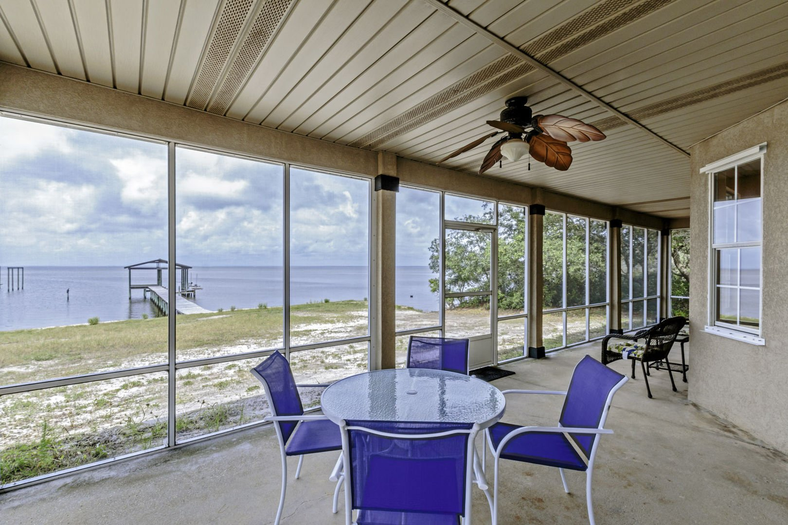 Gorgeous Bayfront Views From The Screened Porch of this Vacation Home in Fort Morgan AL.