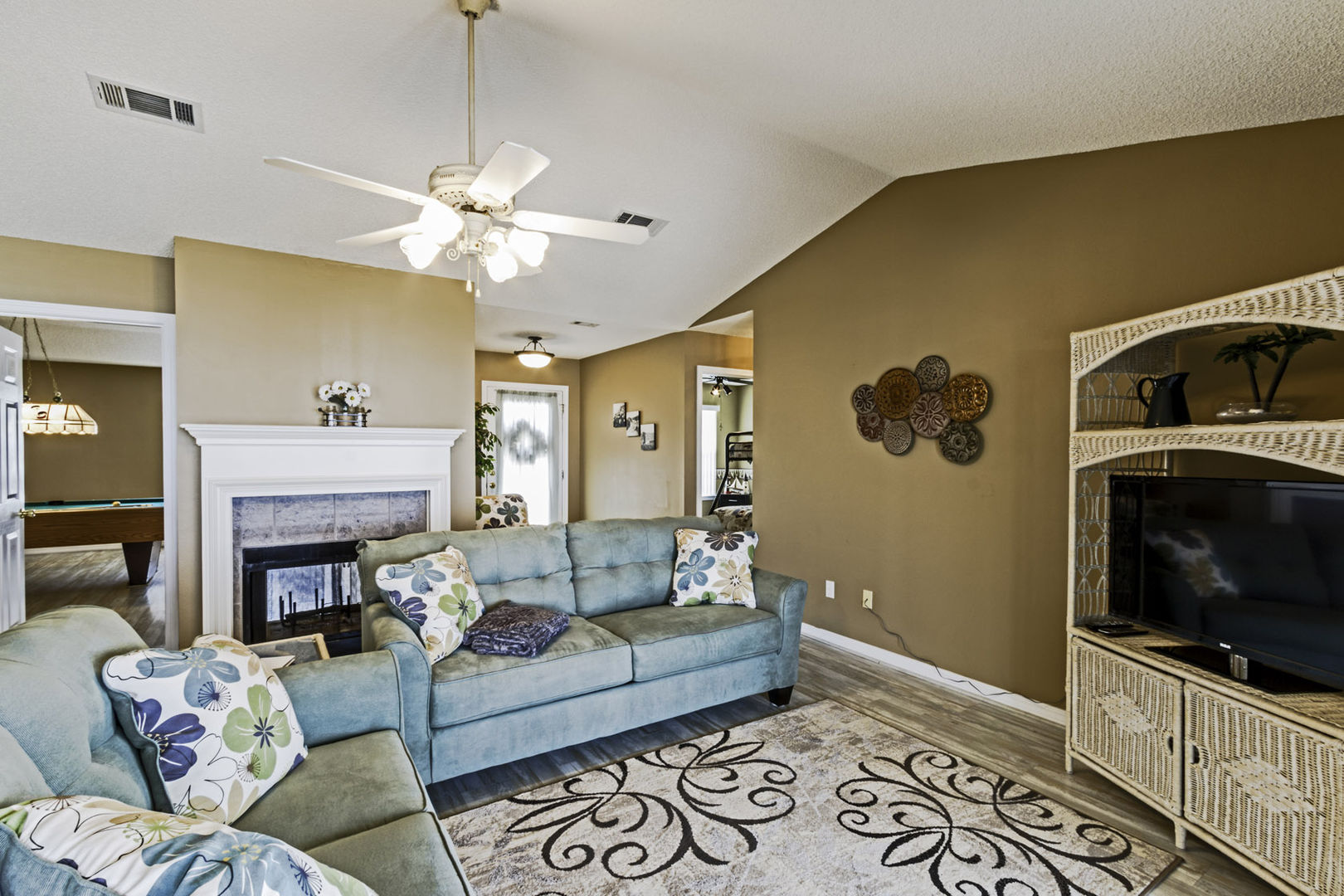 Relaxing and comfy living area with couch and large TV.