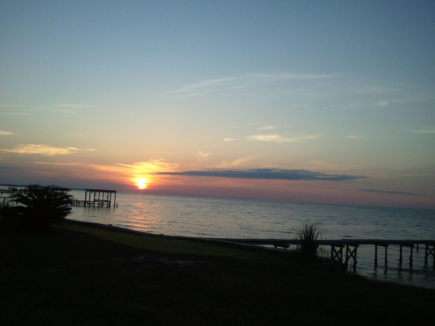Enjoy Beautiful Bay Sunrises & Sunsets from this Vacation Home in Fort Morgan AL.