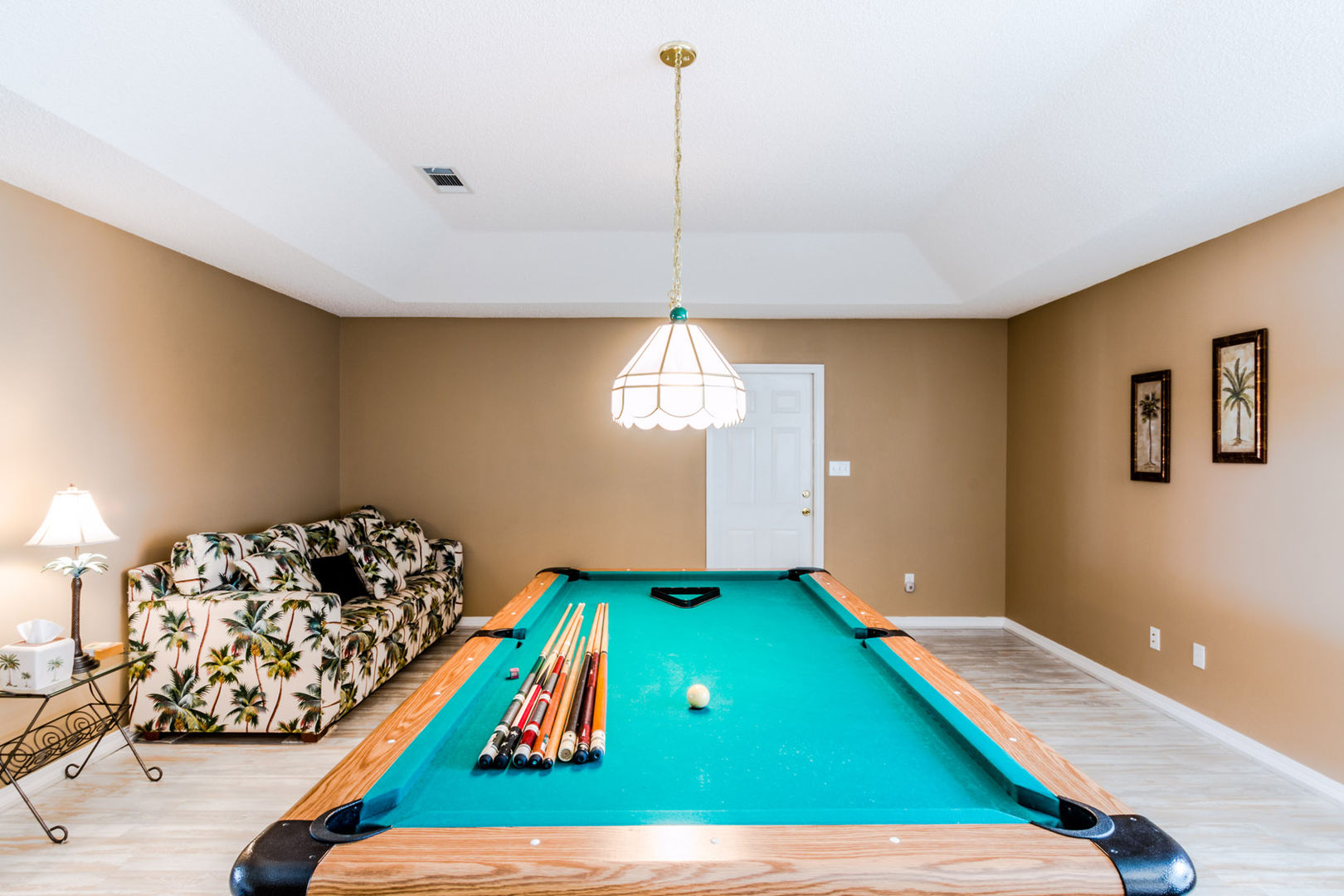 The Gameroom Has A Full Size Pool Table.