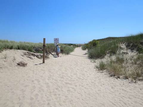 Enjoy the dune walk to Stage Harbor Lighthouse at the far end of Hardings Beach - Chatham Cape Cod New England Vacation Rentals