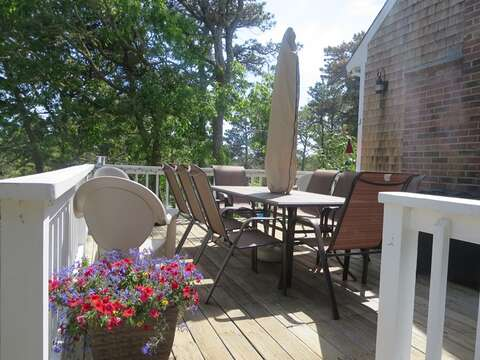 Twinkling lights surround the deck, you will love the outdoor living at this home! - 93 Pine Ridge Road Chatham Cape Cod New England Vacation Rentals