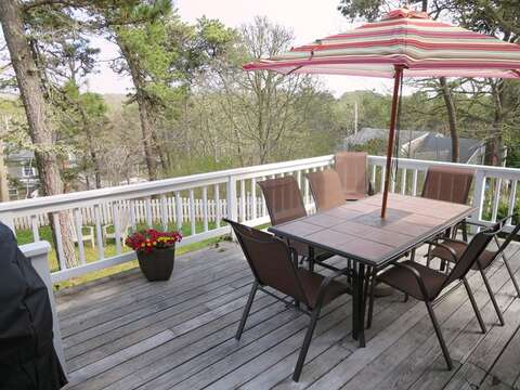 Outdoor deck with table and chairs and gas grill - 93 Pine Ridge Road Chatham Cape Cod New England Vacation Rentals