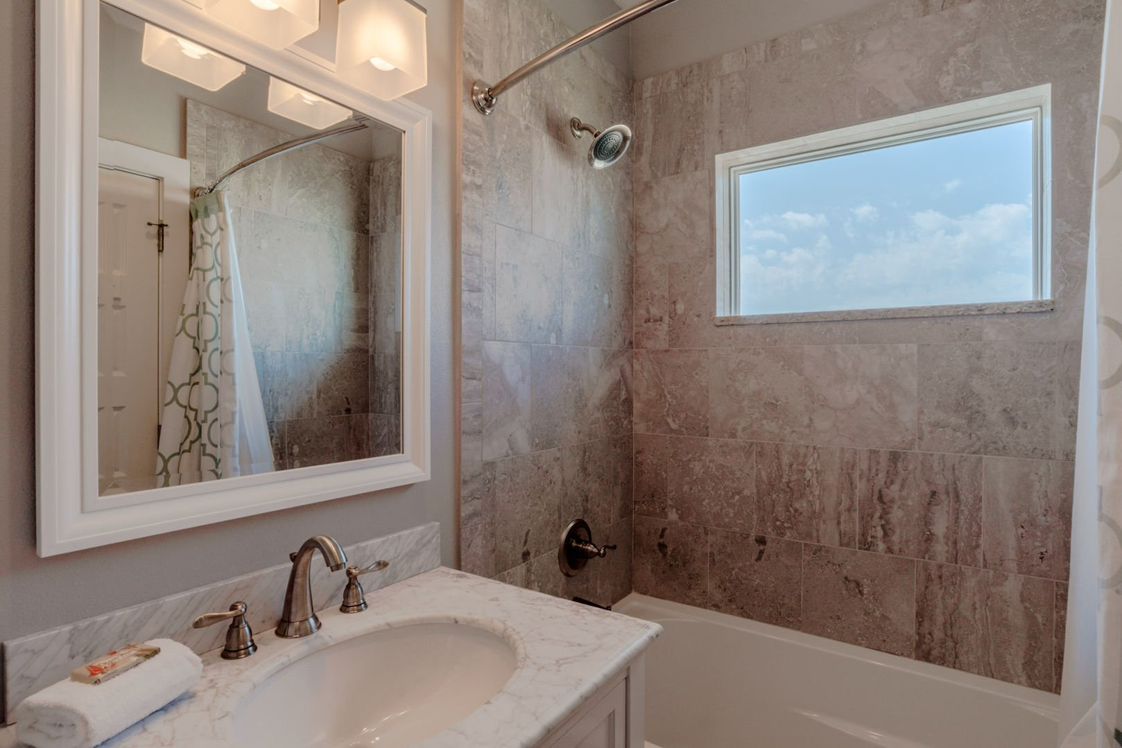 Bathroom with a Tub/Shower Combo and Natural Light