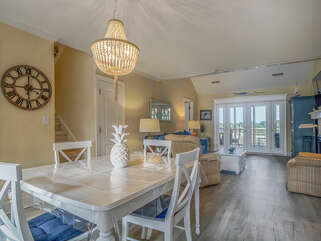 This light and bright Tarpon Pond cottage is perfect for your Seabrook vacation.  The dining table seats six.