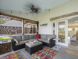 The screen porch couch invites you to take a nap, read a book, or simply enjoy your surroundings!