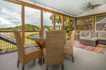 Breathtaking views from the screen porch capture the lagoon and Ocean Winds golf course.