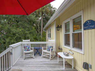 The front porch is the perfect spot for morning coffee or a glass of wine.