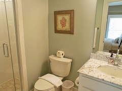 First floor queen bedroom with Full bath with walk-in shower