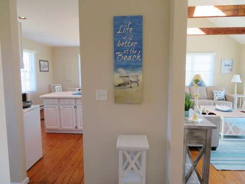 To the right you will find the Coastal living room and to the left is the kitchen and dining area -53 Little Beach Road Chatham Cape Cod New England Vacation Rentals