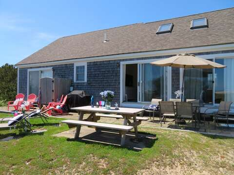 All the outdoor seating you need for a fun day by the beach including a gas grill - 53 Little Beach Road Chatham Cape Cod New England Vacation Rentals