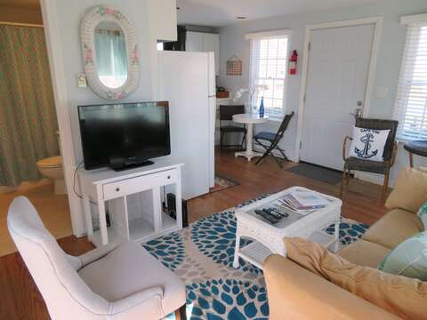 Enjoy your favorite show on the flat screen TV - Open view to kitchen and bath- - 46 Little Beach Road Chatham Cape Cod New England Vacation Rentals