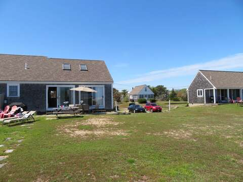 View from water side: Looking to have a family reunion? Rent all 3 sister houses together! 46, 47, and 53 Little Beach Road - 47 Little Beach Road Chatham Cape Cod New England Vacation Rentals   Chatham, Cape Cod  6 bedrooms, 4 bathrooms Will sleep 12!