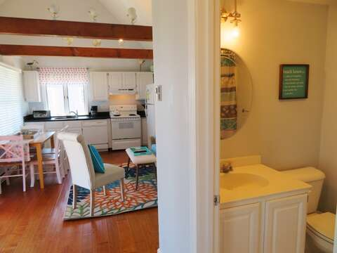 View from hall where bathroom and bedrooms are located out to living area-47 Little Beach Road Chatham Cape Cod New England Vacation Rentals