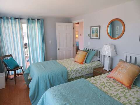 Bedroom 2 with 2 Twins sliders to covered patio- 47 Little Beach Road Chatham Cape Cod New England Vacation Rentals