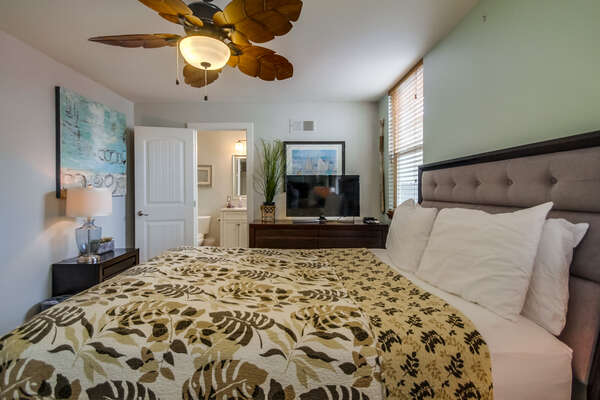 Master Bedroom with Queen Bed, TV, and Ceiling Fan