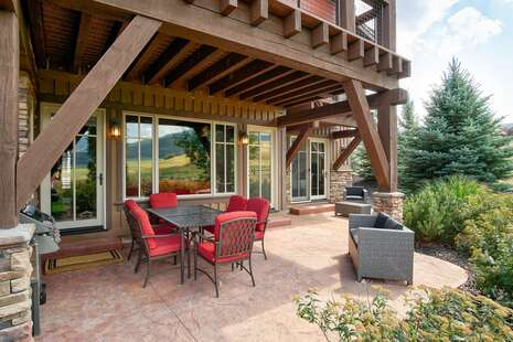 Outdoor porch area with beautiful views of the mountains and lake