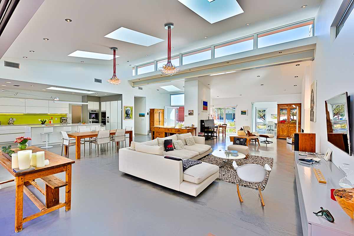 A high ceiling and ample light perfectly accent the unique design of the home
