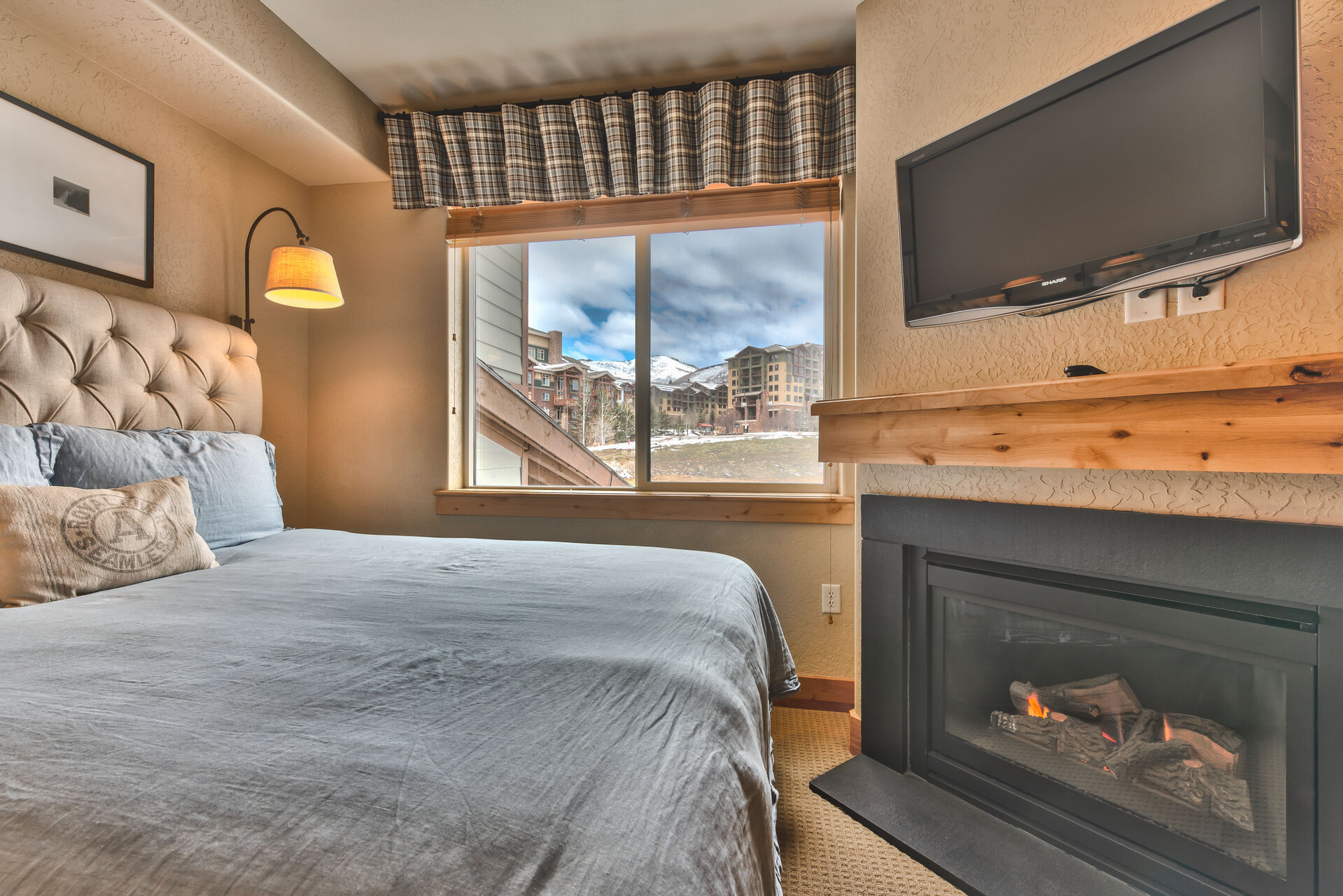 Bedroom 2 with Two Queen beds, a Warm Gas Fireplace, and Mountain Views