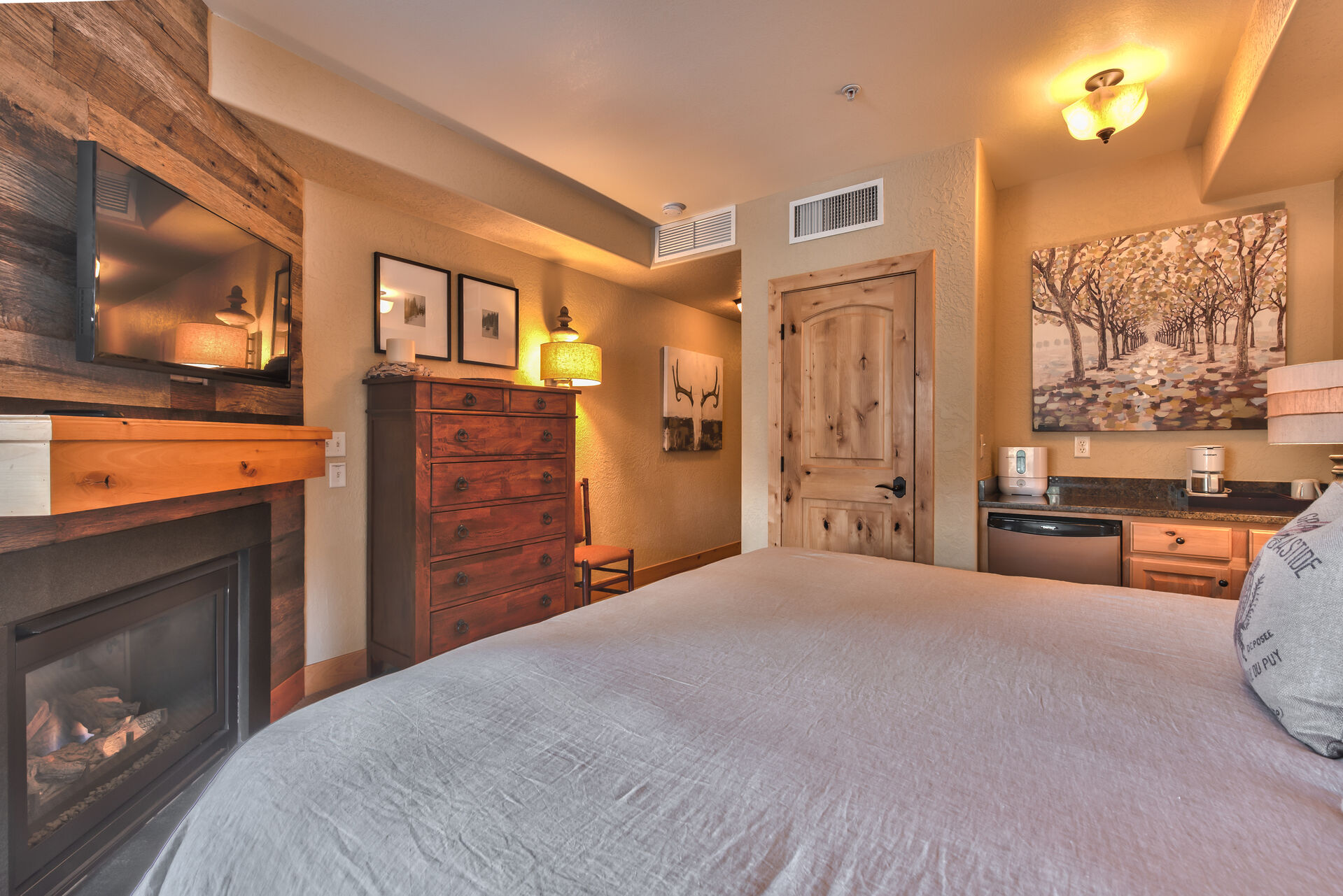 Master bedroom with King Bed, Flat Screen TV, Gas Fireplace, Private Balcony, and Private Bath