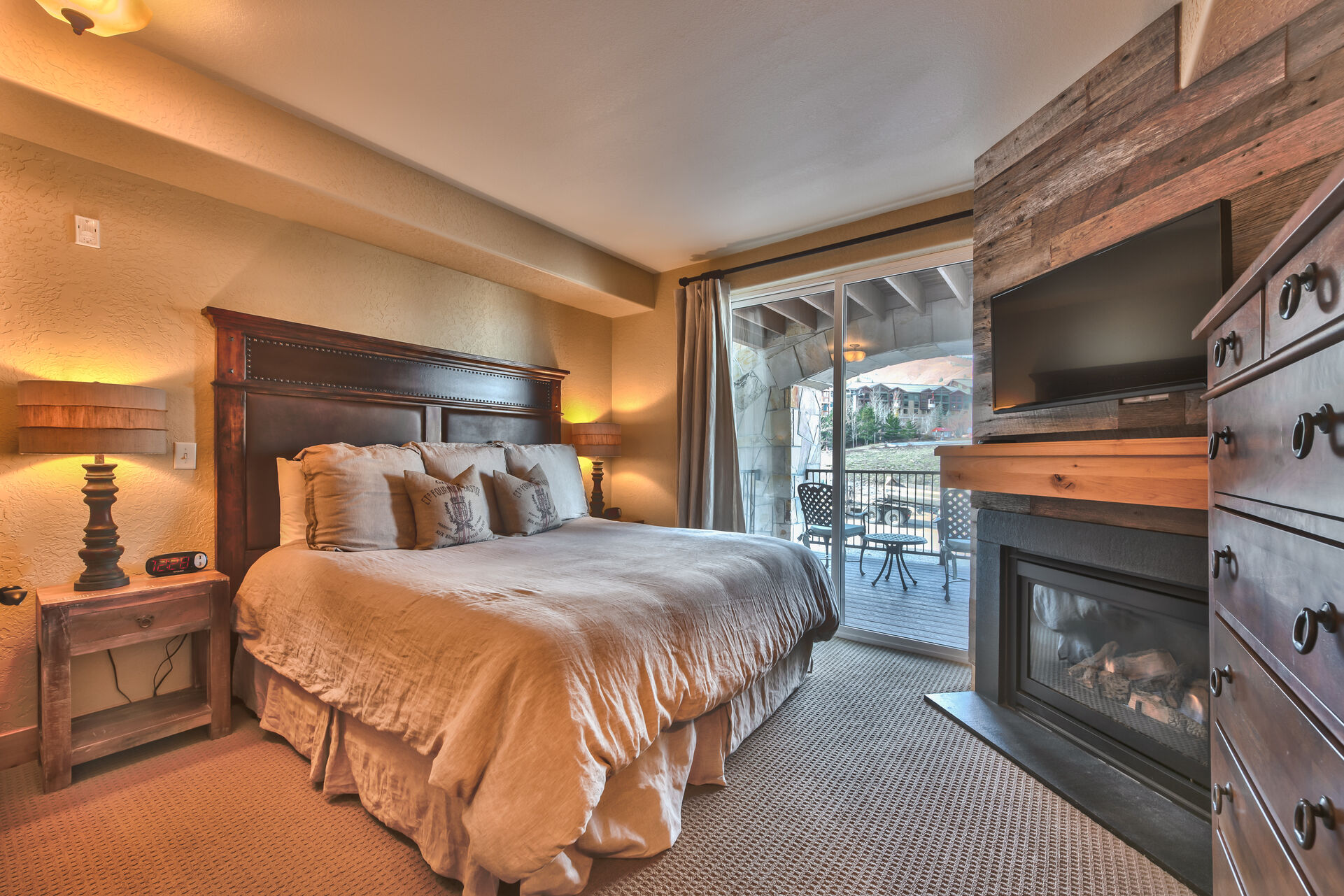 Grand Master bedroom with King Bed, Flat Screen TV, Gas Fireplace, Private Balcony, and Private Bath