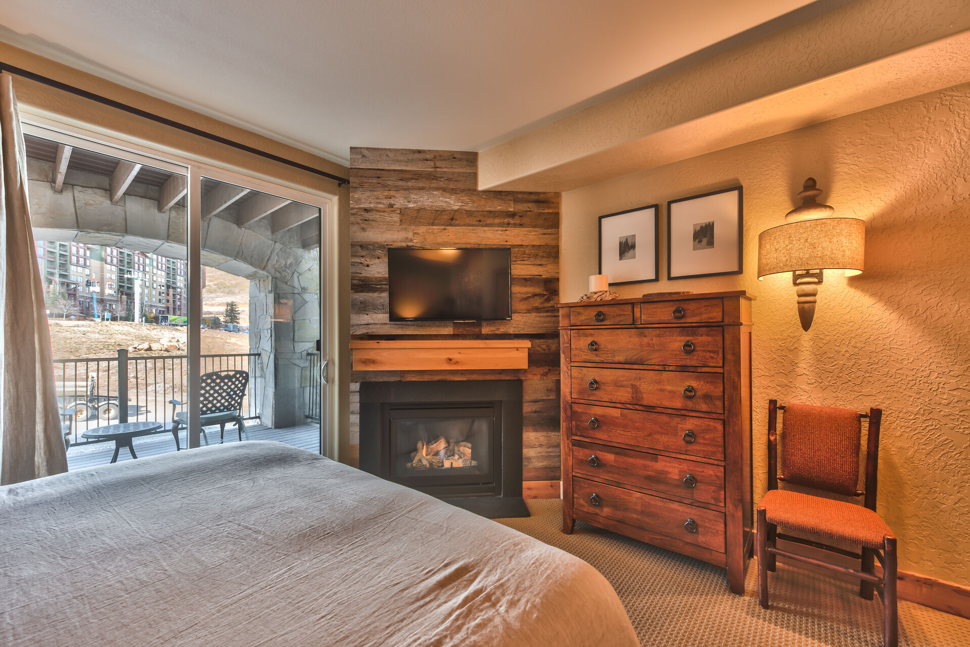 Grand Master bedroom with King Bed, Flat Screen TV, and a Gas Fireplace for a Cozy Ambiance