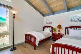 Guest bedroom upstairs with two twin beds.
