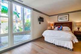 Guest Bedroom wtih Queen size bed & TV on ground floor.