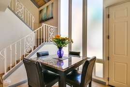 Dining table right as you walk in front door.