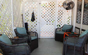 Private outside lounge with fan and shade