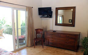 Lower level twin bedroom features air conditioning and satellite television