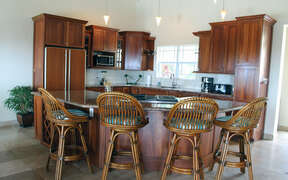 Gourmet kitchen with breakfast bar is part of open Great Room